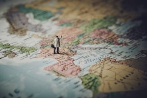 Figure hailing a cab on a world map